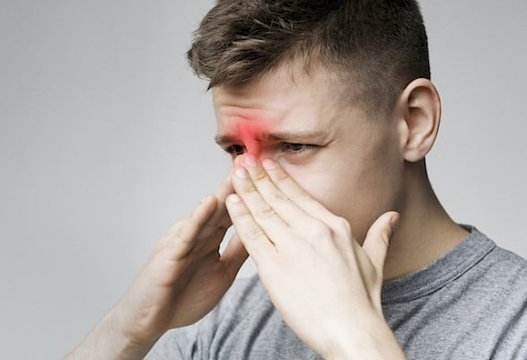 man with sinusitis